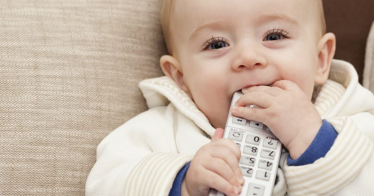 Toddler chewing on remote control, from Funny Stages Kids Go Through, lernin blog